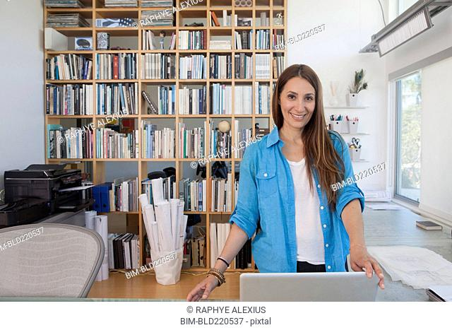 Mixed race woman working in home office