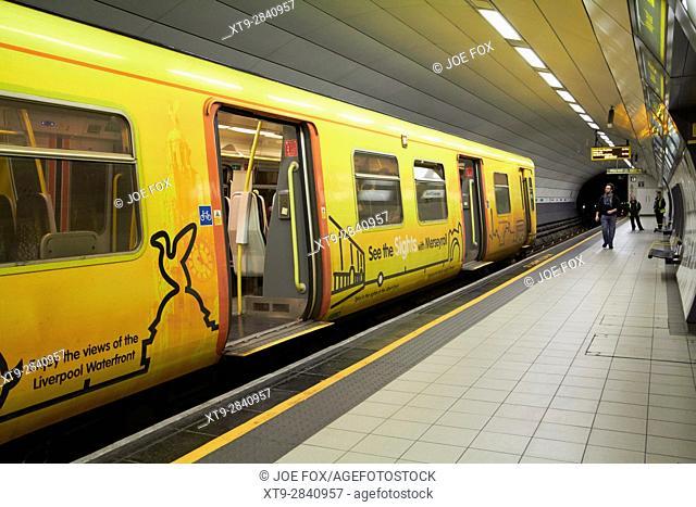merseyrail train in james street underground train station Liverpool UK