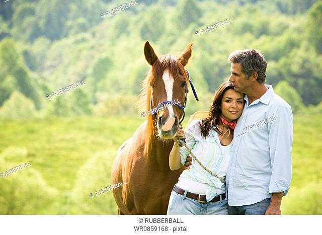 Mature man and a woman with a horse