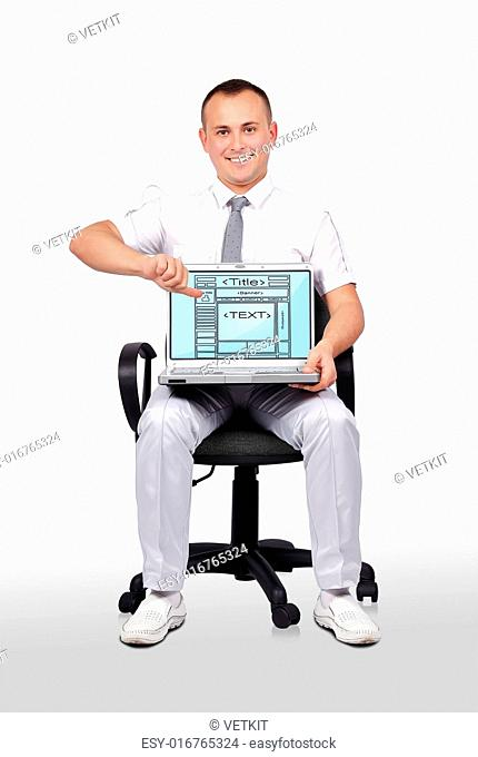 man sitting on chair and holding laptop with template web page