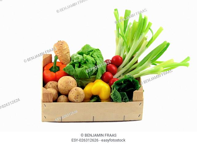 a box with different vegetables on a white background