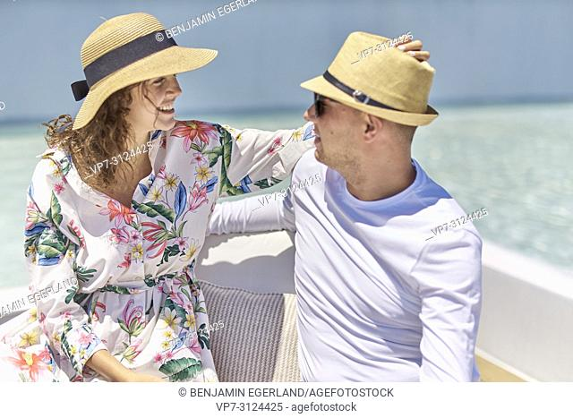 couple on holiday, lovers, togetherness, sun hats, next to pool