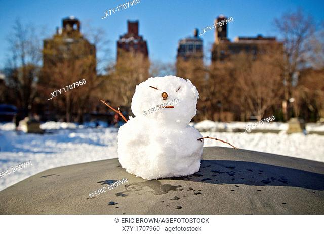 A tiny snowman in Washington Square Park in New York City