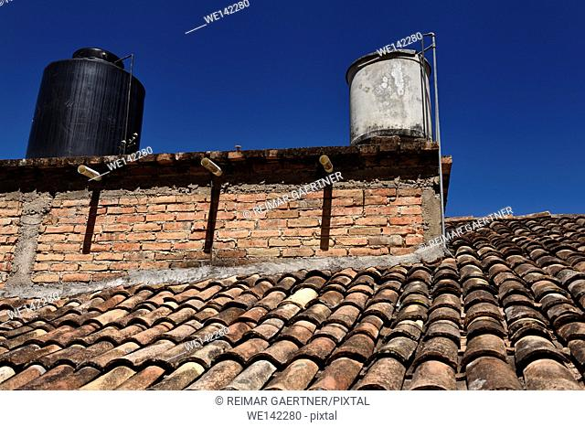 Stone and plastic tinaco rooftop water tanks in Mexico