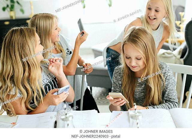 Happy girls using cell phones