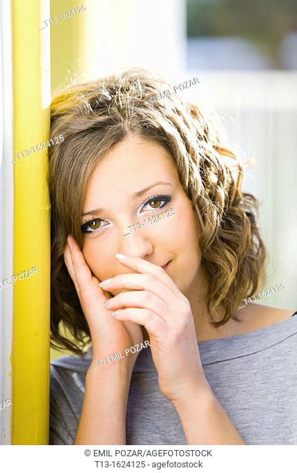 Attractive young woman portrait touching nose