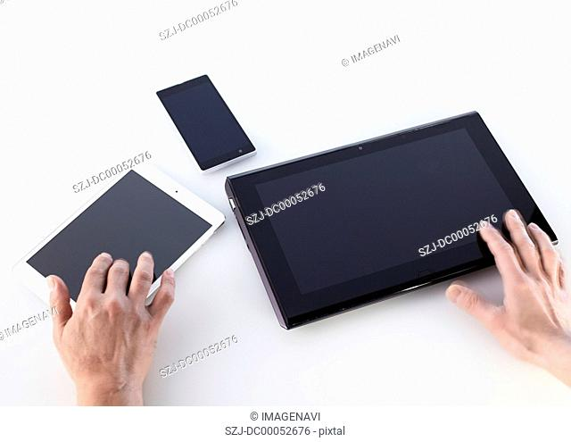 Hands using smart devices