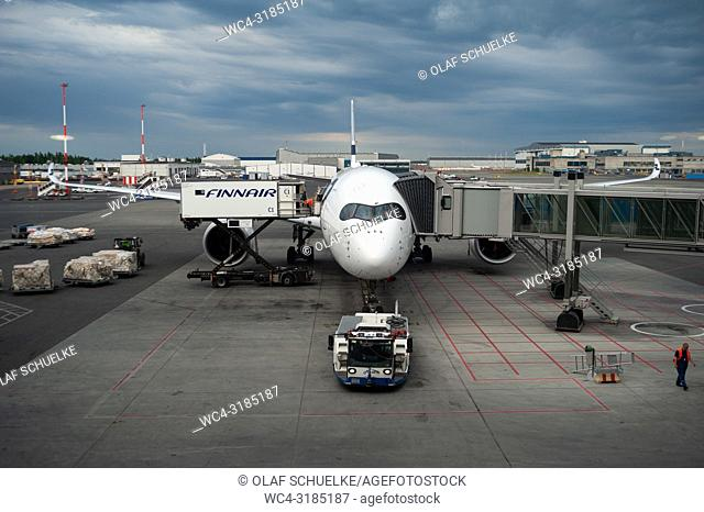 Helsinki, Finland, Europe - A Finnair Airbus A350 passenger plane is parked at a gate at Helsinki's airport Vantaa. Finnair is a member of the One World airline...