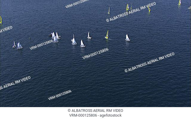 Aerial HD shot of sail boats and windsurfing in the sea