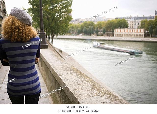 Rear view of woman next to water