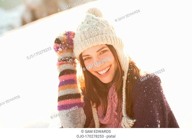 Smailing woman outdoors in snow