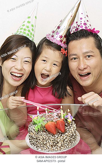 Family with one daughter celebrating a birthday