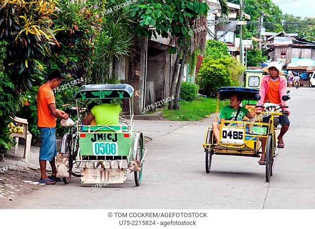 Street scene with pedicabs, CBD, Ozamis City, Misamis Occidental, Mindanao, Philippines