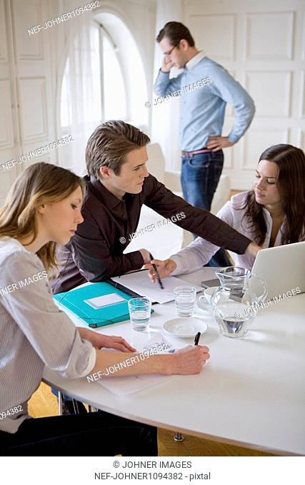 Group of young businesspeople at meeting
