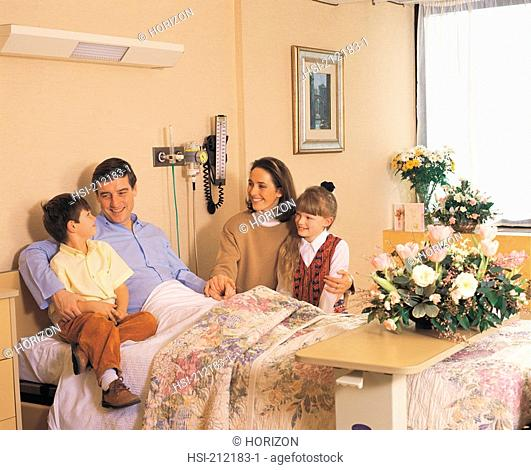 Woman with children visiting her husband at Cromwell Hospital in London, Europe