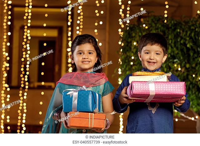 Portrait of children with gifts