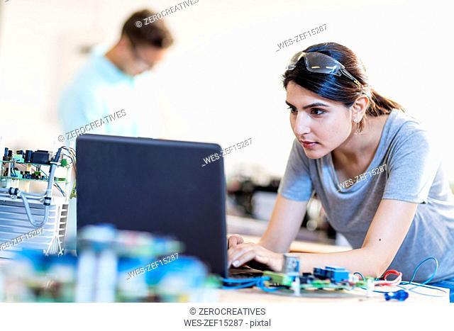 Woman in workshop using laptop