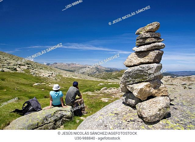Mountaineers practice mountaineering in the mountains of the Sierra de Gredos National Park  At the end of the image the summit of Almanzor peak  Navacepeda de...