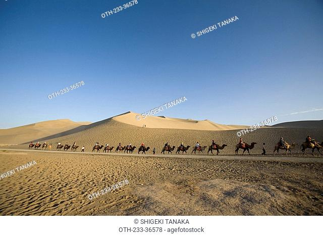 Camel back riding on Mingsha Mountain, Dunhuang, China