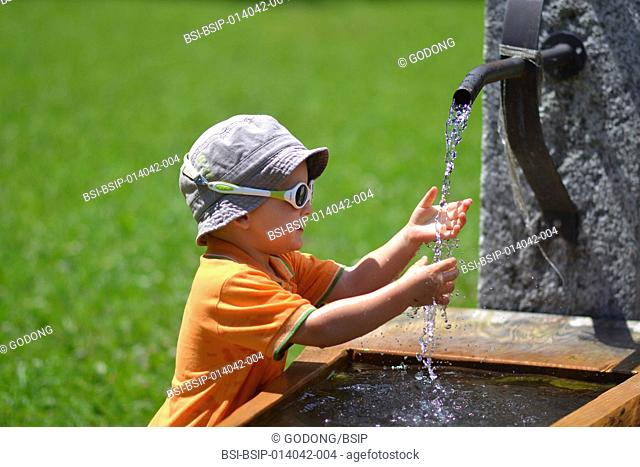 Child at a fountain