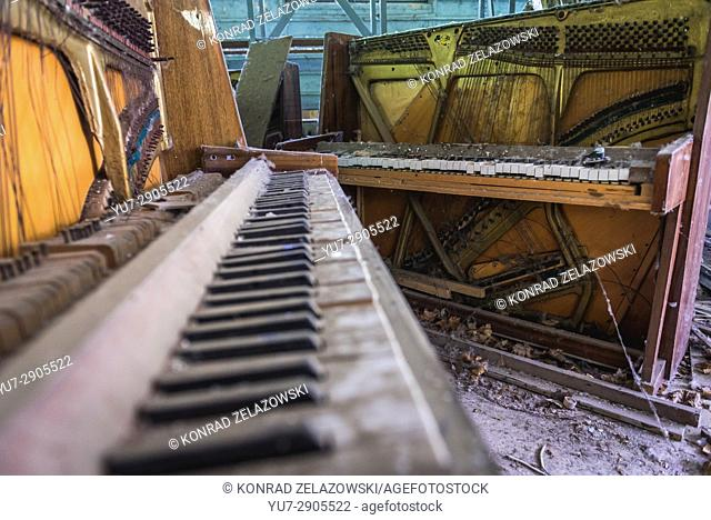 Destroyed piano in abandoned music shop in Pripyat ghost city of Chernobyl Nuclear Power Plant Zone of Alienation in Ukraine