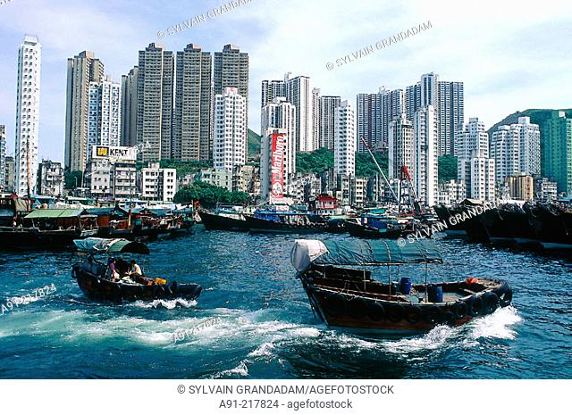 Aberdeen skyline and chinese boats on their way. Hong Kong. China