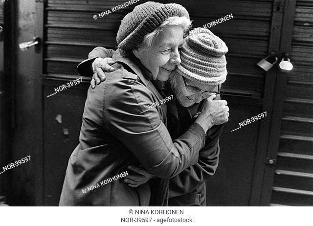 Old women hugging each other on the street