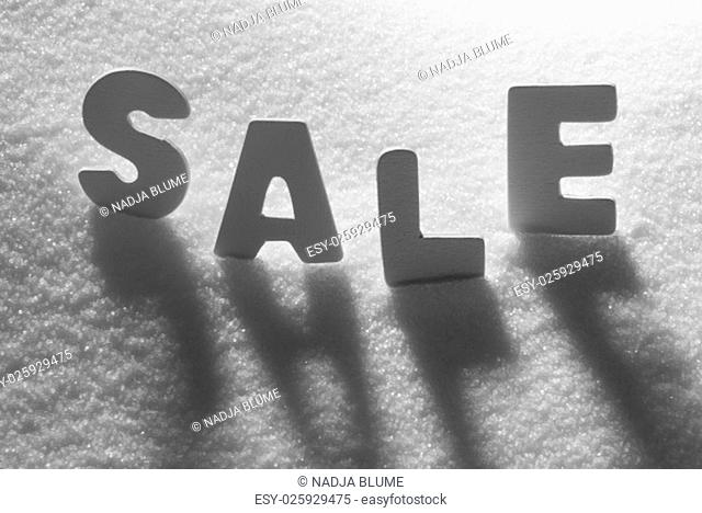 White Letters Building English Text Sale On White Snow. Snowy Landscape Or Scenery. Christmas Card For Seasons Greetings Or Usable As Background