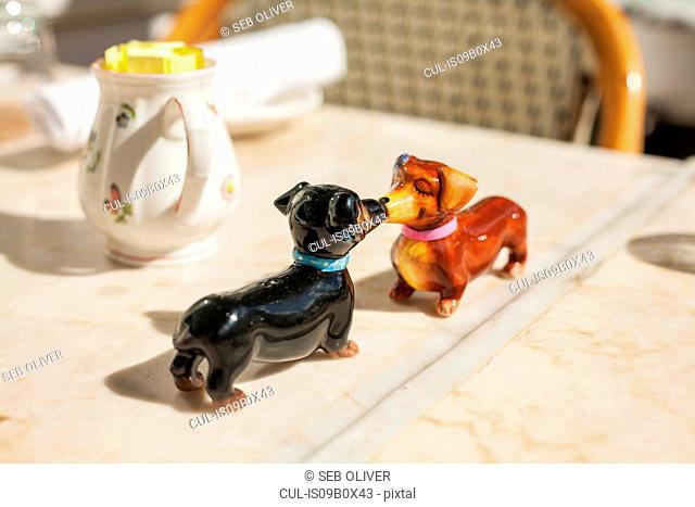Dachshund ornaments face to face on table, New York, USA