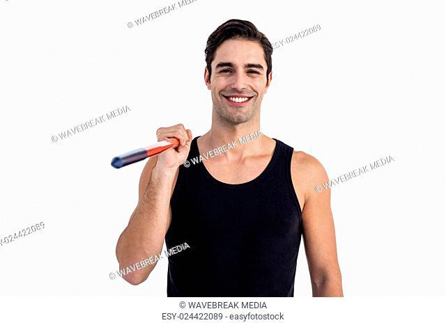 Portrait of happy male athlete holding javelin