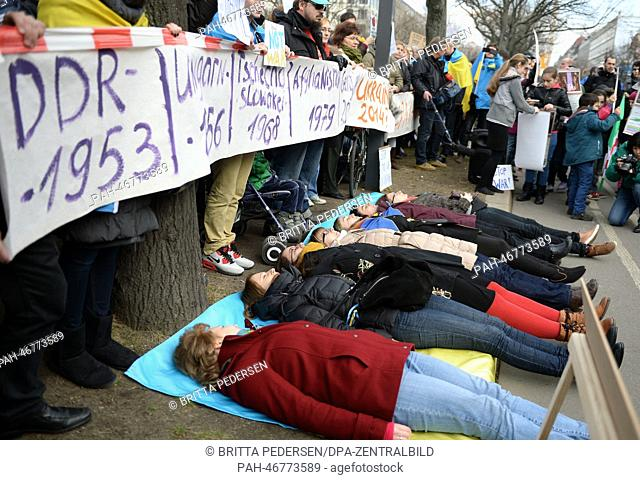 Demonstrators hold a minute of silence to commemorate the victims of the power struggles in Ukraine and remember the Soviet-Russian interventions in the past...