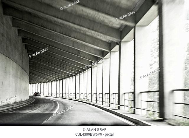 Car driving through covered highway with pillars, Bolzano, Trentino Alto Adige, Italy