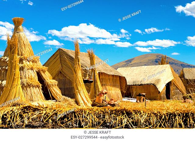 Reed huts on a manmade floating island on Lake Titicaca in Peru
