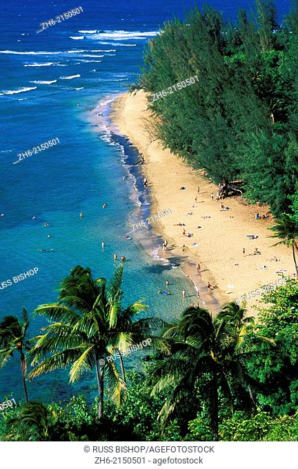 Sunbathers and blue Pacific waters at Ke'e Beach, North Shore, Island of Kauai, Hawaii USA