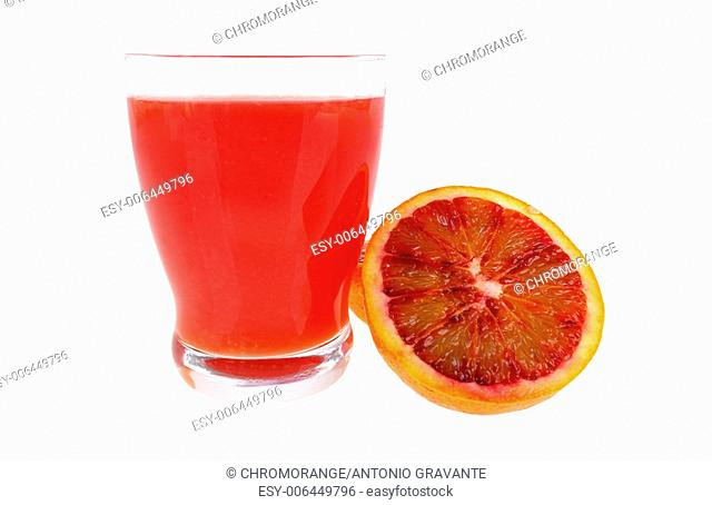 Red orange juice in a glass and oranges