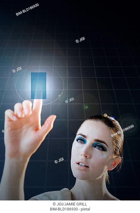 Caucasian woman using holographic touch screen