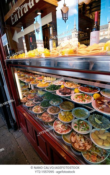 Traditional tapas and spanish food bar in the Plaza Mayor, a grand arcaded square in the center of Madrid is very popular with tourists and locals alike  The...