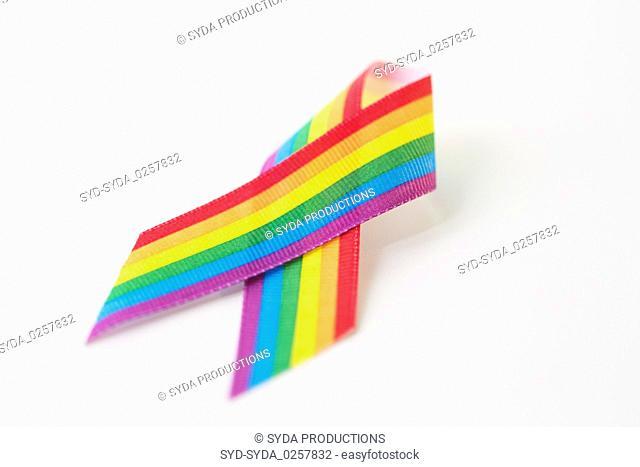 close up of gay pride awareness ribbon on white