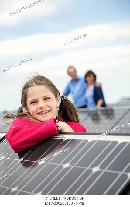 Young girl portrait photo-voltaic panel solar