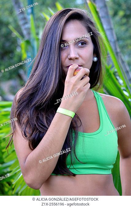 Girl eating fruit. Venezuela