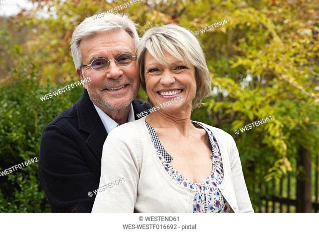 Germany, Kratzeburg, Senior couple smiling, portrait