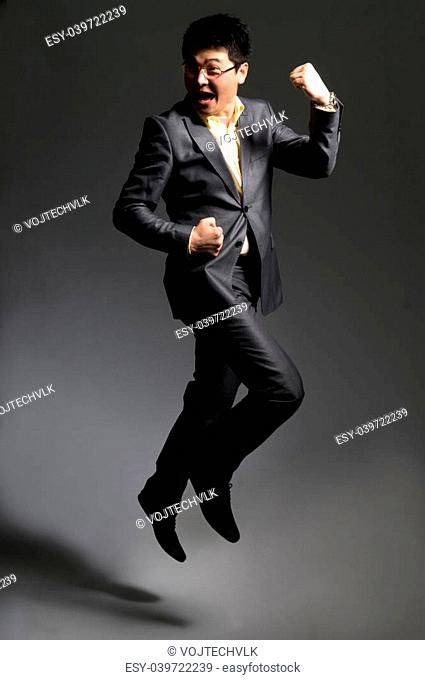 Jumping happy businessman