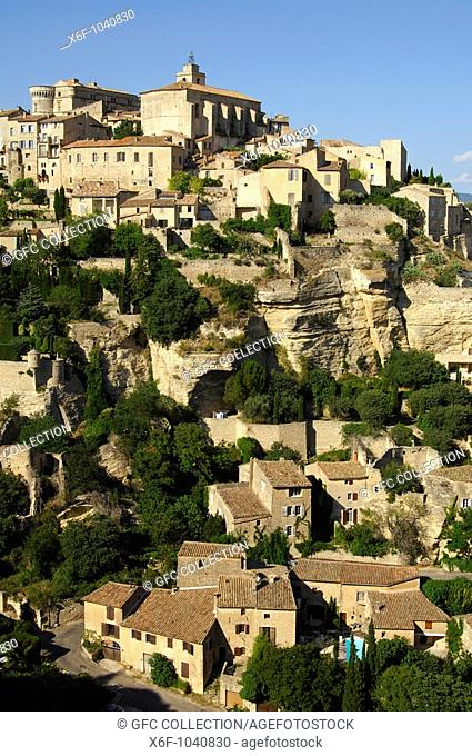 Gordes with the Château de Gordes and the Saint-Firmin church on the Monts de Vaucluse hill, Provence, France