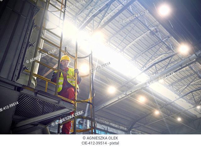Steelworker on platform in steel mill