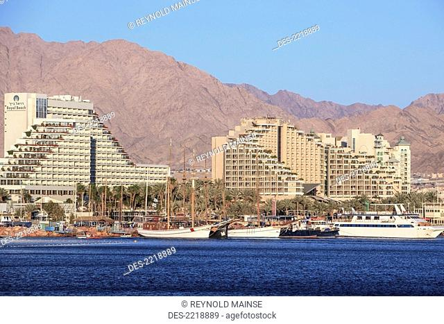 Buildings Along The Water And Boats In The Harbour, Jordan Israel