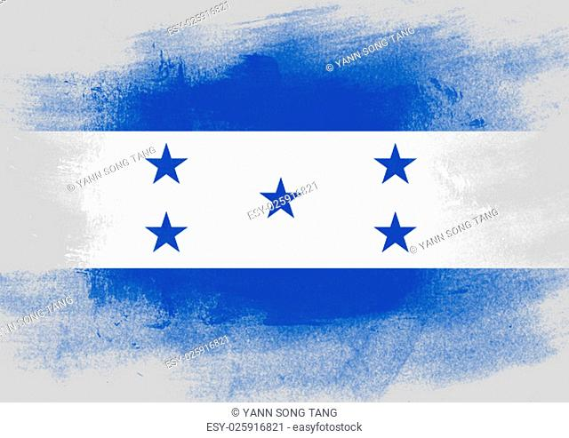 Flag of Honduras painted with brush on solid background