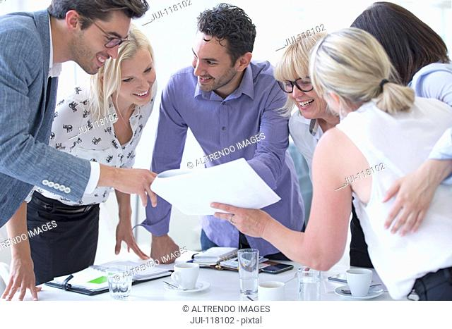 Business Meeting Around Table In Modern Office