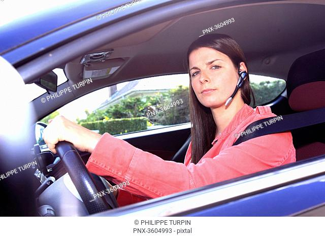 France driving woman with phone