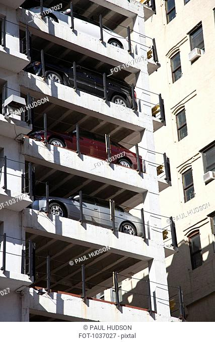 A column of parked cars in a multi storey car park