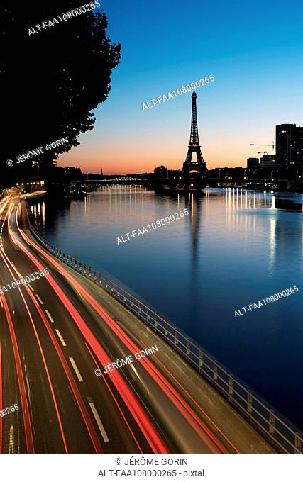 France, Paris, light trails along the Seine at twilight